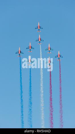 DUBAI, UAE - NOVEMBER 11, 2007: The world's oldest aerobatic demonstration team, the French Patrouille de France, in vertical flight over Dubai. - Stock Photo