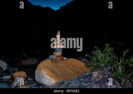 Cairn,  a human-made pile of stones., built as a marker for the petroglyphs in Red Rock Canyon, Las Vegas, Nevada, USA. - Stock Photo