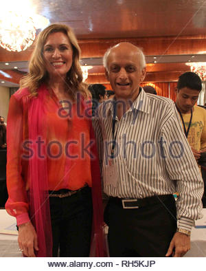 Sandra de Castro Buffington, Director, Health & Society (HH&S) with Mukesh Bhatt Bollywood filmmaker during a panel discussion on 'Building Bridges between creative communities & and priorities of our time' in Mumbai, India on July 18, 2013. (Amol Kamble) - Stock Photo