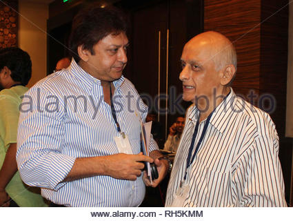 Sashi Ranjan with Bollywood filmmaker Mukesh Bhatt during a panel discussion on 'Building Bridges between creative communities & and priorities of our time' in Mumbai, India on July 18, 2013. (Amol Kamble) - Stock Photo