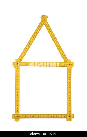 Yellow meter ruler folded as house isolated on white background - Stock Photo
