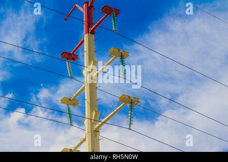 White and red light pole with a blue sky with white clouds in the background on a wonderful day in Mexico - Stock Photo