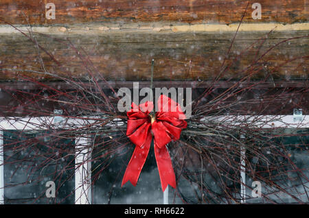 Red ribbon and wreath decorate the Historic Upper Ford Ranger Station, a U.S Forest Service rental cabin. Kootenai National Forest, Northwest Montana. - Stock Photo