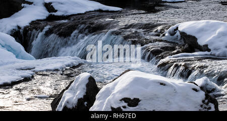 Winter scene of the Elbow Falls in Kananaskis country. - Stock Photo