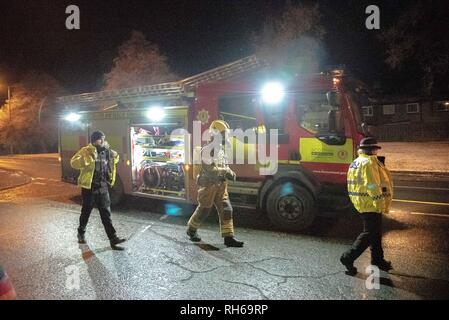 Two Police officers are seen walking on to the scene with a member of the Fire Service is seen in full respiratory system. A car caught fire tonight on the B9096 in Tullibody. Fire & Rescue and Police were on scene. There were no injuries. Fire & Rescue brought the fire under control and put it out. - Stock Photo