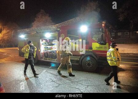 Tullibody, Clackmannanshire, UK. 31st Jan, 2019. Two Police officers are seen walking on to the scene with a member of the Fire Service is seen in full respiratory system.A car caught fire tonight on the B9096 in Tullibody. Fire & Rescue and Police were on scene. There were no injuries.Fire & Rescue brought the fire under control and put it out. Credit: Stewart Kirby/SOPA Images/ZUMA Wire/Alamy Live News - Stock Photo