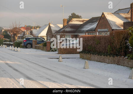 Ferring west Sussex, UK. Friday 1 st Febuary. UK weather. After moderate snowfall last night Ferring wakes to snow covered roads making driving treacherous on untreated roads. Â Credit: Photovision Images News/Alamy Live News - Stock Photo