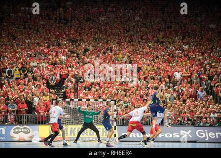Feature, a red wall with the fans from the watch the match, Sander SAGOSEN (NOR) has the ball, goalkeeper Niklas LANDIN (DEN) in goal, Action, Final, Norway (NOR) - Denmark (DEN) 22:31, on 27.01.2019 in Herning/Denmark Handball World Cup 2019, from 10.01. - 27.01.2019 in Germany/Denmark. | usage worldwide - Stock Photo