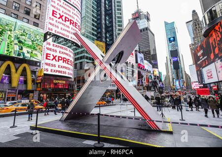 New York, New York, USA. 1st Feb, 2019. An X-shaped artwork is seen at Times Square in New York City. The 6-meter-high work celebrates 'Valentines Day' on February 14, but work is from day 1 to day 28/2. At the center of the work is seen the phrase 'In Difference, Add Equality, Find Love, Do not Forget the Flowers.' Credit: William Volcov/ZUMA Wire/Alamy Live News - Stock Photo