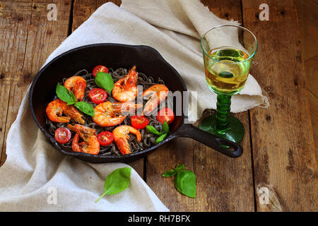 Still life with grilled shrimps and white wine on wooden background - Stock Photo