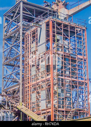 image of the metal structure of an abandoned factory in the city of rotterdam with a blue sky background in the Netherlands Holland - Stock Photo