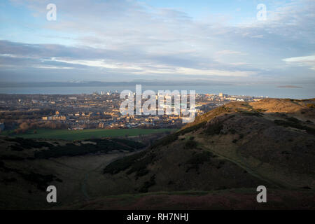 The view north from the top of Arthur's Seat in Edinburgh, with the Hibernian Football Club stadium at Easter Road and Leith visible. Arthur's Seat is a landmark hill in the centre of Holyrood Park, a popular vantage point overlooking Edinburgh. - Stock Photo