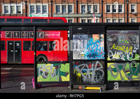 A graffiti-covered bus stop in Brixton, on 30th january 2019, in Lambeth, south London, England. - Stock Photo