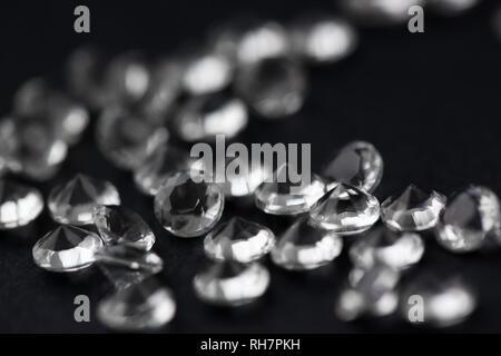 Scattering of white star diamonds on black - Stock Photo