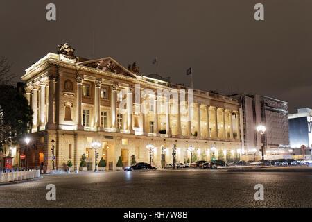 Night view of Crillon Palace in Place de la Concorde - Paris, France - Stock Photo