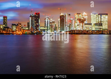 London Skyline, river Thames in front of the skyscrapers of the commercial estate Canary Wharf - Stock Photo