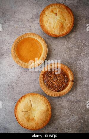 Different various types of mini pies background - Stock Photo
