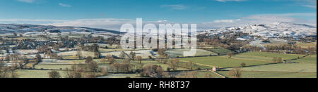 North Pennines AONB panoramic landscape, view from Whistle Crag over Teesdale into Lunedale with snow covered hills in the distance in bright winter s - Stock Photo