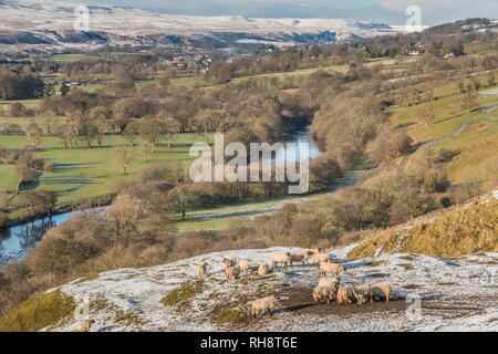 North Pennines AONB landscape, view from Whistle Crag towards Middleton-in-Teesdale and Holwick with snow covered hills in the distance - Stock Photo