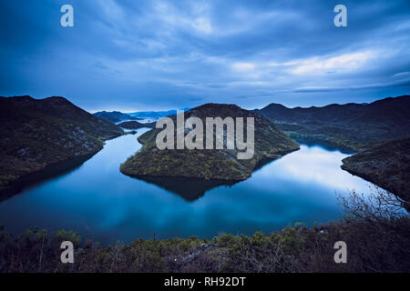 The hill called the Green Pyramid and the bend of the Rijeka Crnojevica River, Skadar Lake National Park, Montenegro - Stock Photo