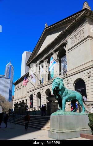 Bronze lion guard the Michigan Avenue Entrance of Art Institute of Chicago.Chicago.Illinois.USA - Stock Photo