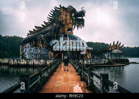Dark tourism attraction Ho Thuy Tien abandoned waterpark, close to Hue city, Central Vietnam, Southeast Asia. Famous Dragon statue in the middle of th