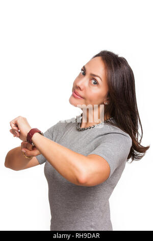 Beautiful young woman pointing at wristwatch with index finger as you are late gesture isolated on white background - Stock Photo