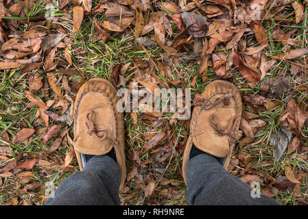 Standing in the fallen Autumn leaves. - Stock Photo