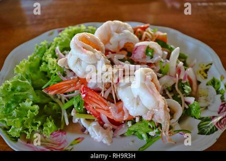 Diet menu, Seafood Salad - shrimp, squid, octopus, greens. - Stock Photo