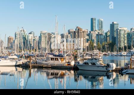 Marina with sailboats, back city centre with skyscrapers, Coal Harbour, Vancouver, British Columbia, Canada - Stock Photo