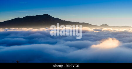 Mount Maroma standing above the clouds at sunrise. Viewed from Comares, Axarquia, Malaga, Andalucia, Spain. 4th November 2018 - Stock Photo
