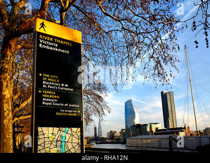 London, England, UK. River Thames, tourist information map and buildings on the South Bank seen from the Victoria Embankment. - Stock Photo