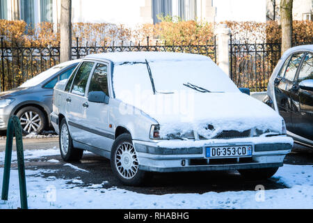 Strasbourg, France - Dec 18, 2018: Vintage Volvo 740 limousine car parked on French street in the winter - Stock Photo
