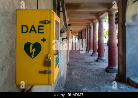 Meldola, Italy, close up of an automated external defibrillator (in italian abbreviation is DAE) place on public street - Stock Photo
