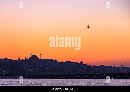 Istanbul, Turkey : Skyline at sunset as seen through the Golden Horn. - Stock Photo