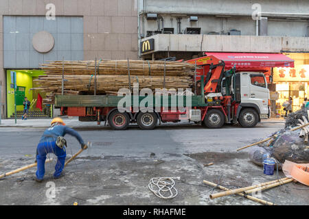 Kowloon, Hong Kong - April 22, 2017: Bamboo Scaffoldings at Truck in Mong Kok, Hong Kong, China. - Stock Photo