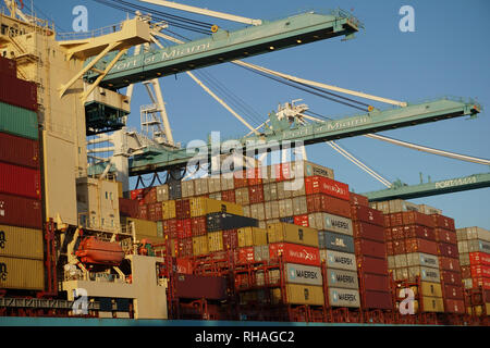 The Miami harbour with ships carrying contain exports.  Photo by Dennis Brack - Stock Photo