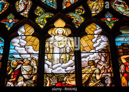 Edinburgh, Scotland - August 26, 2018: Religious colorful stained glass window inside St Giles cathedral. - Stock Photo