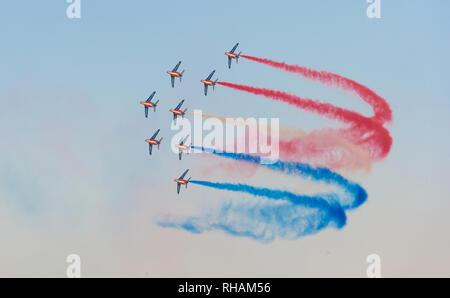 DUBAI, UAE - NOVEMBER 11, 2007: The world's oldest aerobatic demonstration team, the French Patrouille de France, flying over Dubai in the UAE. - Stock Photo