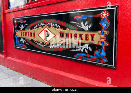 Powers Whiskey artwork advertising on the side of Temple Bar pub in Dublin Ireland - Stock Photo