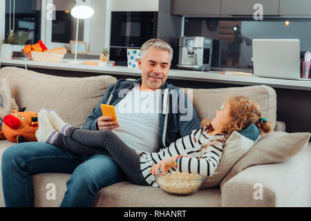 Grey-haired bearded attractive man in sportswear looking relaxed - Stock Photo