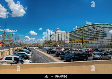 Large luxury cruise ship Navigator of the Seas docked at Lisbon - Stock Photo