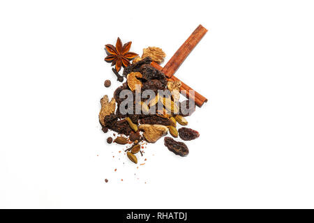 Fragrant spices for making hot winter drink - mulled wine: cinnamon sticks, anise stars, spicy ingredients from dried organic seasoning in a handful o - Stock Photo