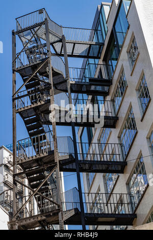 Fire Escape stairs on the building wall in London, UK - Stock Photo