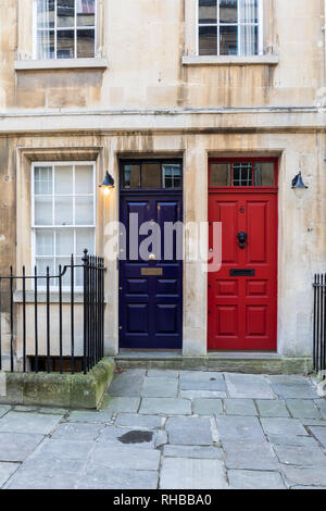Blue and red front doors in North Parade, Bath, England - Stock Photo