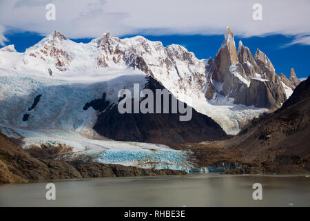 Clouds over lake Torre (Laguna Torre) near mountains of Cerro Torre, Fitz Roy in summer day, Santa Cruz, Argentina, South America - Stock Photo
