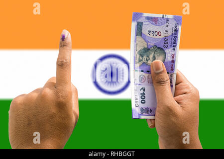 Hand holding money and vote a concept of political corruption the purchase of votes in elections on isolated background. - Stock Photo