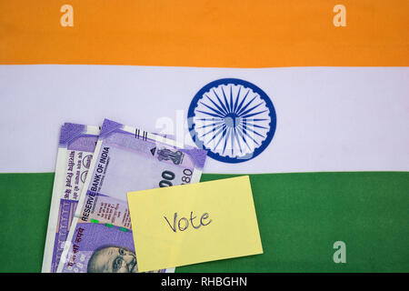 political corruption in India and concept the purchase of votes in elections on indian flag. - Stock Photo