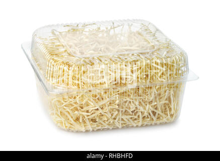 Dry egg noodles in clear plastic container isolated on white - Stock Photo
