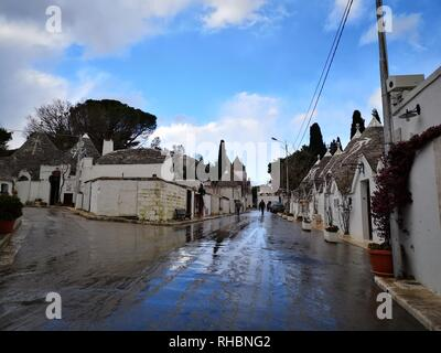 Beautiful view of the traditional trulli houses with their conical roof in Alberobello, Apulia - Italy - Stock Photo